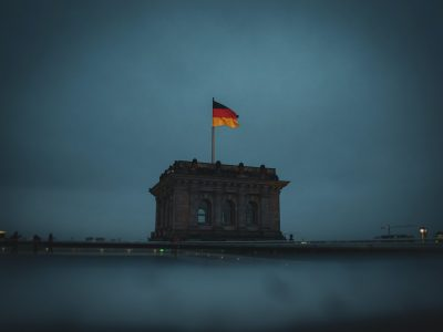German flag on top of Berlin Reichstag.