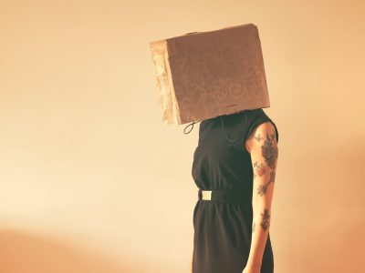 Lady with box over her head.