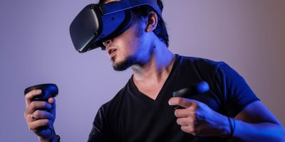 Man in black playing virtual reality
