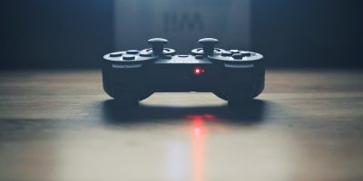 Playstation game controller on table.