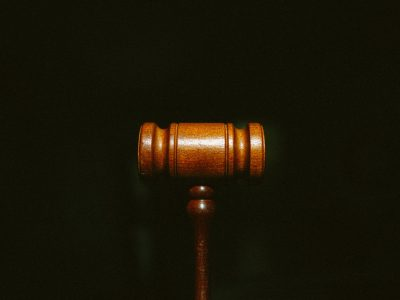 A law gavel with a black background,