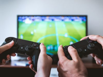 Hands holding the game controllers.