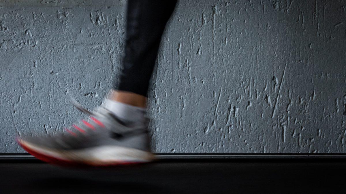 Person's foot on treadmill.
