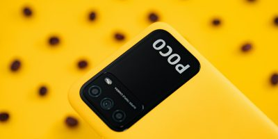 pocophone m3 flatlay yellow background with coffee beans